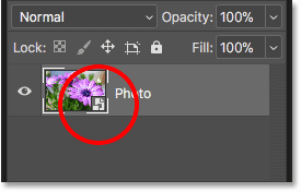 The smart object icon in the layer preview thumbnail