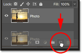 Dragging the Photo layer onto the New Layer icon in the Layers panel