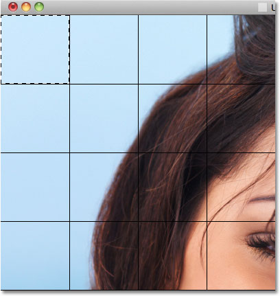 Selecting the top left square in the grid.