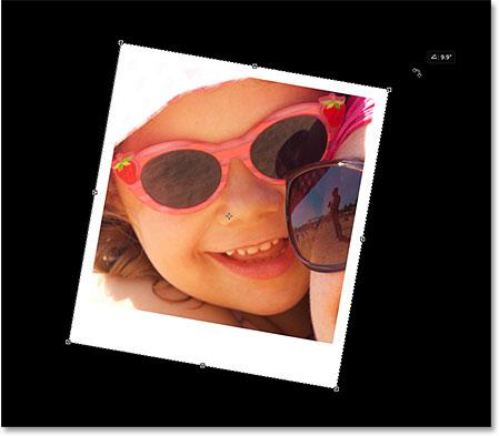 Rotating the polaroid with Free Transform. Image © 2014 Photoshop Essentials.com