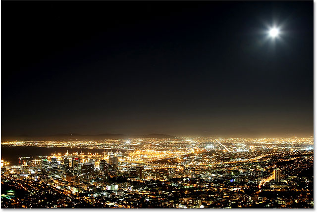 Cape Town harbor and city at night with moon in the sky. Image 59821666 licensed from Shutterstock by Photoshop Essentials.com