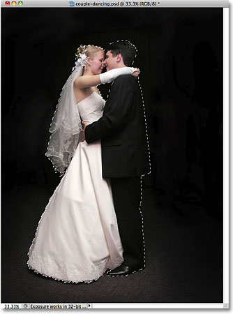 Selecting the wedding couple in the photo.