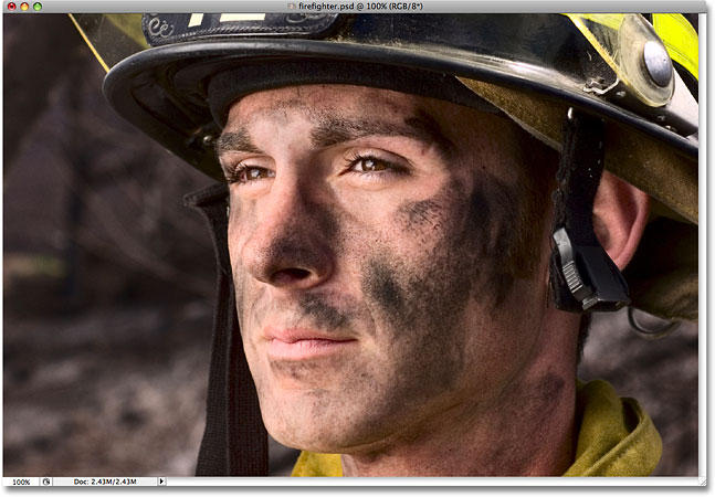A photo of a firefighter. Image licensed from iStockphoto by Photoshop Essentials.com.