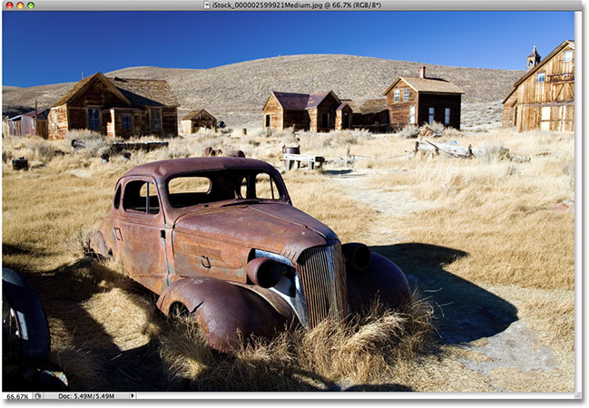 A photo of an old antique car. Image licensed from iStockphoto by Photoshop Essentials.com.
