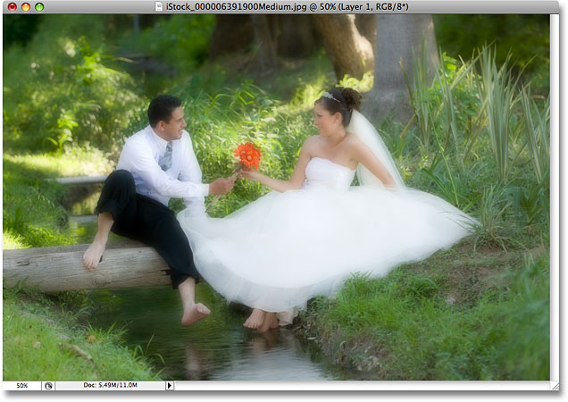 The photo after lowering the opacity of the blurred layer. Image © 2008 Photoshop Essentials.com.