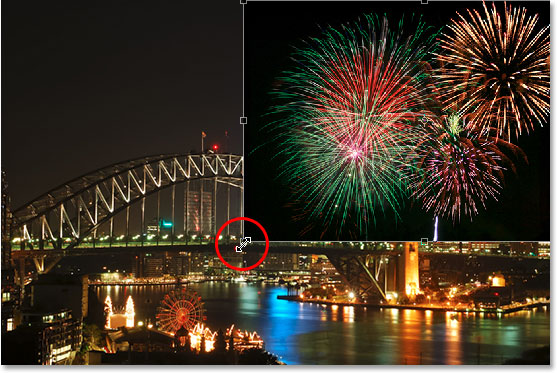 Moving and resizing the fireworks with the Free Transform command in Photoshop.