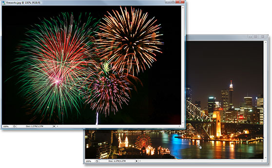 Dragging the fireworks photo into the second photo's document window with the Move Tool.