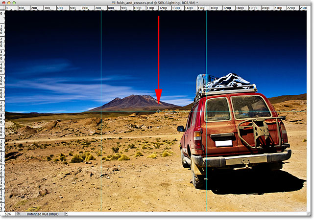 Dragging out a horizontal guide in Photoshop.