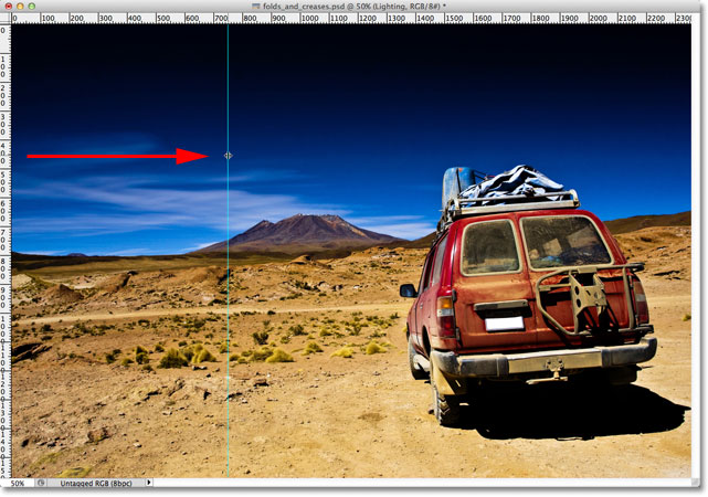 Dragging out a vertical guide in Photoshop.