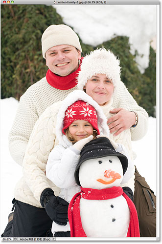 A photo of a family outdoors in winter. Image licensed from iStockphoto by Photoshop Essentials.com.