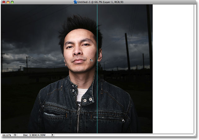 Dragging the photo to the left side of the guide in Photoshop. Image © 2008 Photoshop Essentials.com.