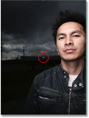 The rotation point target symbol for the Free Transform command in Photoshop. Image © 2008 Photoshop Essentials.com.