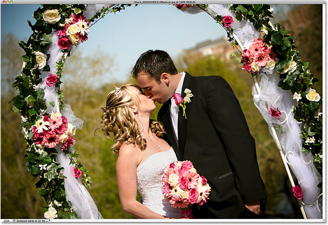 A photo of a newly wed couple. Image licensed from iStockphoto by Photoshop Essentials.com.