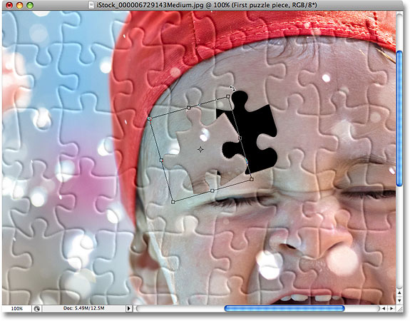 Moving and rotating the puzzle piece. Image © 2008 Photoshop Essentials.com.