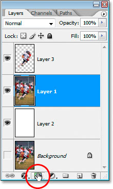 Clicking the 'Add A Layer Mask' icon at the bottom of the Layers palette.
