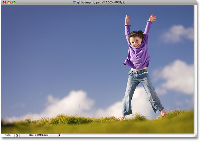 A young girl jumping outdoors. Image licensed from iStockphoto.com by Photoshop Essentials.com.