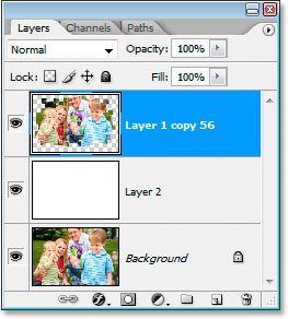 Photoshop's Layers palette now showing only three layers, including the new merged layer at the top.