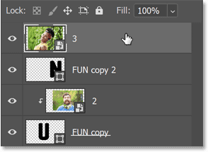 The image was added above the third letter in Photoshop's Layers panel.