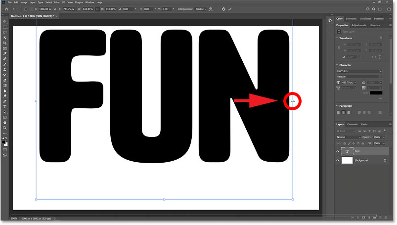 Dragging the transform handles to resize the text.