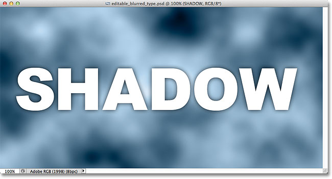 The drop shadow appears around the edges of the letters in the document window. Image © 2012 Photoshop Essentials.com.