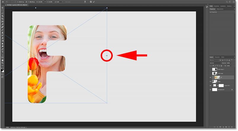 Resizing and moving the image inside the letter with Photoshop's Free Transform command