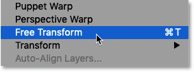 Selecting the Free Transform command from the Edit menu in Photoshop