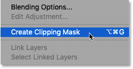 Choosing the Create Clipping Mask command in Photoshop