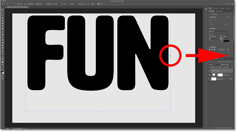 Dragging the transform handles to resize the text in the Photoshop document