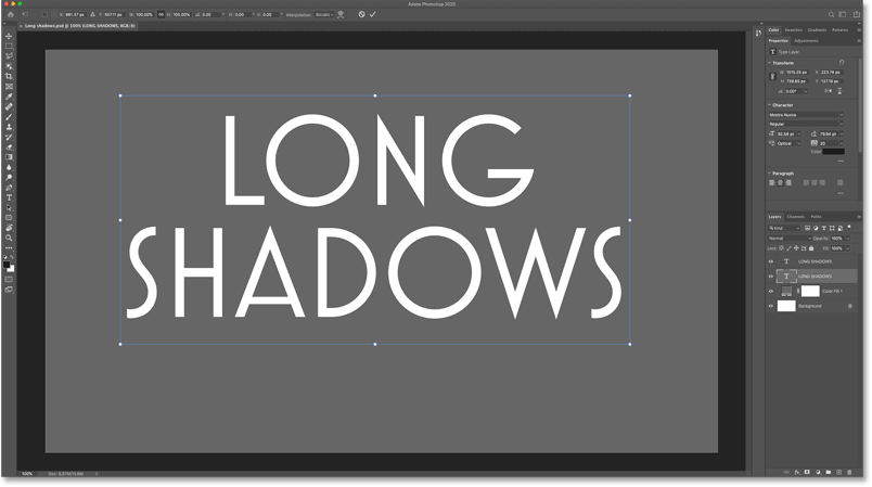 The Free Transform box and handles around the text in the Photoshop document