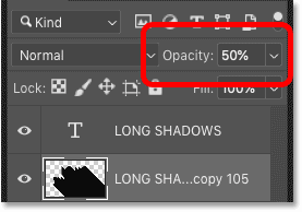 Lowering the shadow's opacity to 50 percent in Photoshop's Layers panel