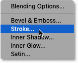 Choosing Stroke from the list of layer effects in Photoshop's Layers panel