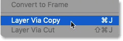 Selecting the 'New Layer via Copy' command in Photoshop
