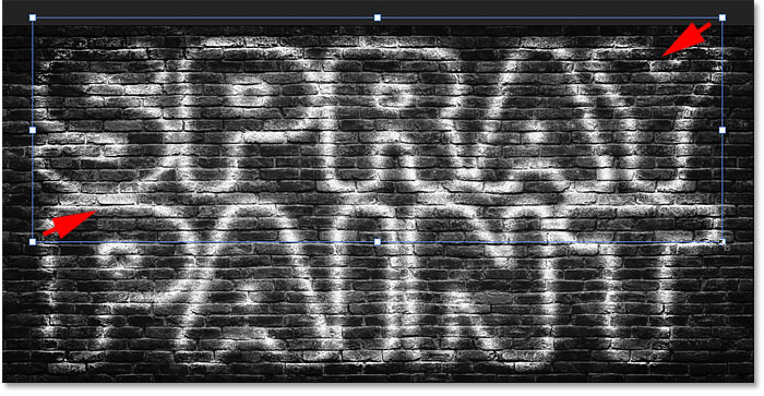 Resizing the copy of the spray painted text effect in Photoshop