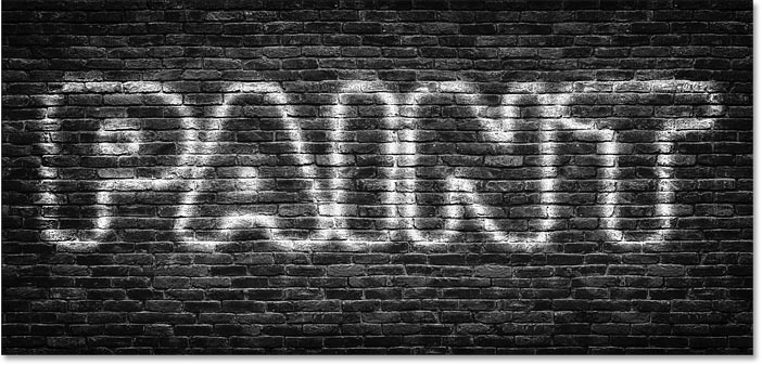 Photoshop spray-painted text effect with the text blended in with the background