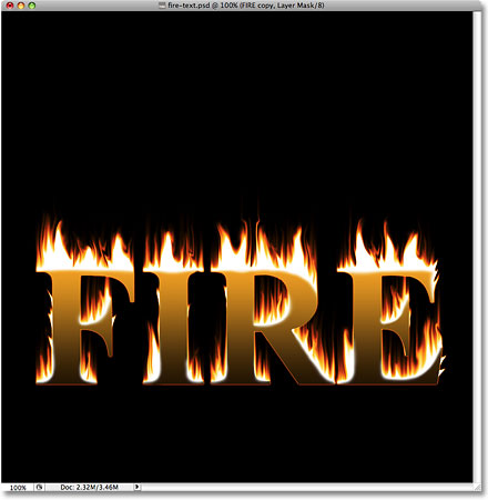 The text and the flames now appear blended together. Image © 2009 Photoshop Essentials.com.