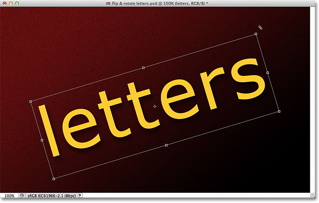 Rotating the text with Free Transform. Image © 2011 Photoshop Essentials.com.