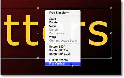 Selecting the Flip Vertical command from the Free Transform contextual menu. Image © 2011 Photoshop Essentials.com.